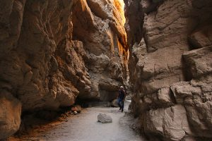 Photographer Brian Munoz hiking through the lower Slot Anza Borrego Desert State Park CA